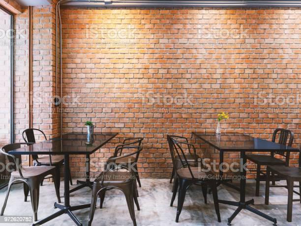 Modern loft style cafe with black table set and brick wall picture id972620782?b=1&k=6&m=972620782&s=612x612&h=g6v4ovuzbk7v4fhtlrk0sjm c8gt9ih 25muyxl kk4=