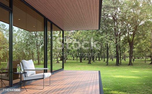 istock Modern loft style house in a large garden 3d render 1142443966