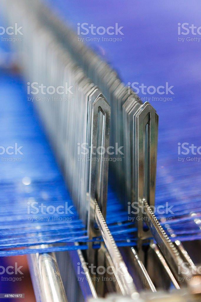 Modern looms with blue thread macro stock photo