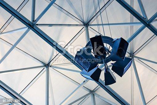 Modern loudspeaker system on a ceiling construction made of metal struts.