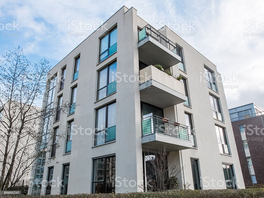 Modern low rise apartment building with balconies stock for Building balcony