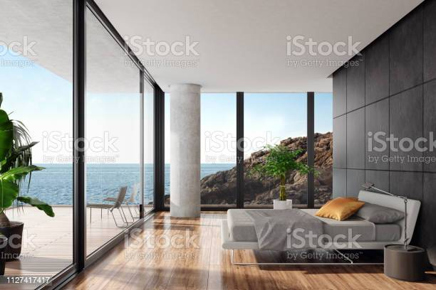 Modern luxurious bedroom in a seaside villa with black stone wall picture id1127417417?b=1&k=6&m=1127417417&s=612x612&h=oiyxyb4i0kjge4eal5xtkhqi0pq6dwktcefcdtq15uw=