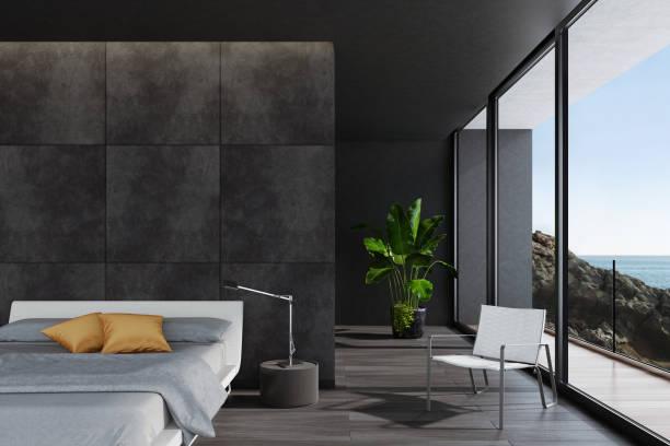 Moderne luxuriöse schwarze Schlafzimmer in einer Villa am Meer – Foto