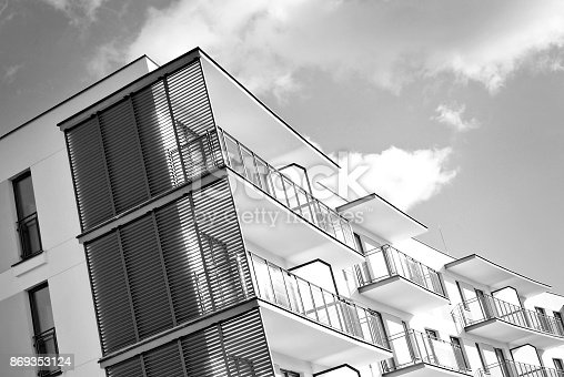 680603734 istock photo Modern, Luxury Apartment Building. Black and white 869353124