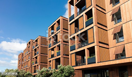 A large modern development of luxury flats in Auckland, New Zealand, with a hardwood facade.