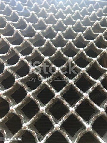 921871456 istock photo Modern luxury car close-up of grille 1182368640