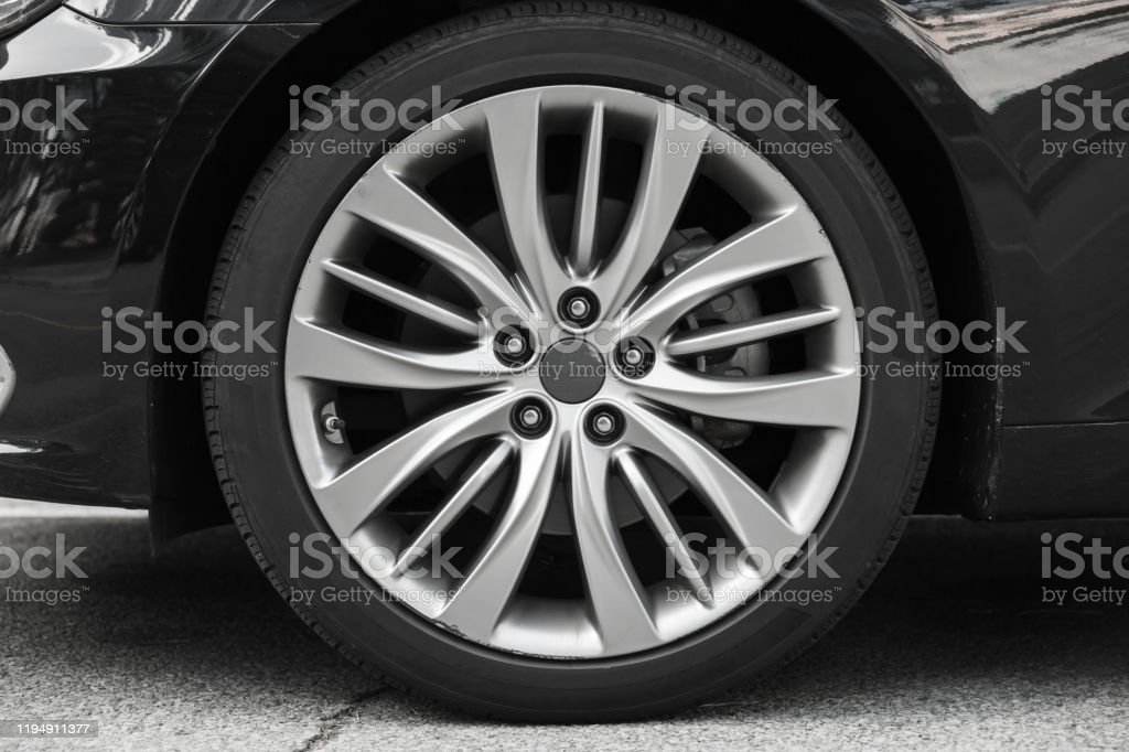 Modern Luxury Car Wheel On A Light Alloy Disc Stock Photo Download Image Now Istock