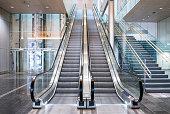 istock Modern luxury escalators with staircase 958770796