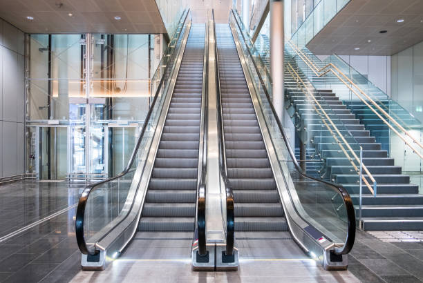 Modern luxury escalators with staircase stock photo