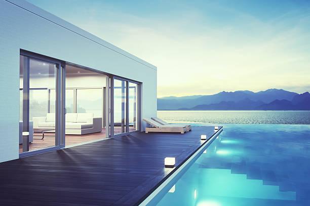 moderne luxus-haus mit schwimmbad im morgengrauen - traumhaus stock-fotos und bilder