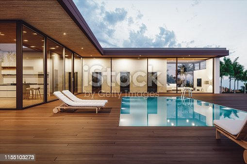 Modern luxury villa with private swimming pool at dusk.