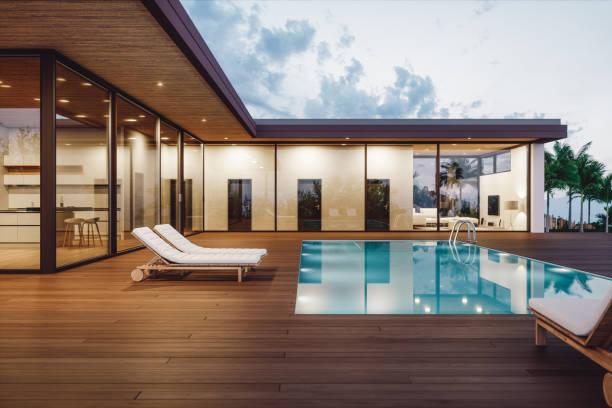 nowoczesny luksusowy dom z prywatnym basenem o zmierzchu - luksus zdjęcia i obrazy z banku zdjęć