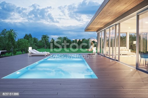istock Modern Luxury House With Swimming Pool At Dawn 825151386