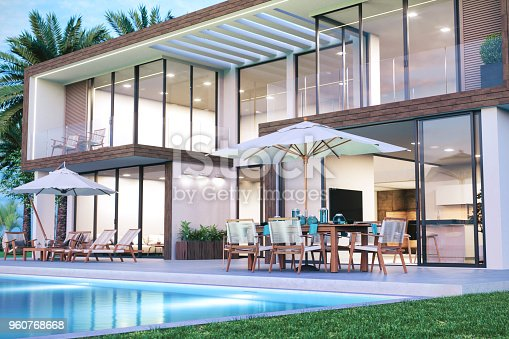 Contemporary luxury holiday villa with swimming pool and patio furnitures.