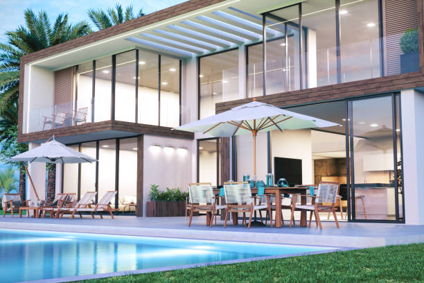 Modern Luxury House With Swimming Pool Contemporary luxury holiday villa with swimming pool and patio furnitures. holiday villa stock pictures, royalty-free photos & images