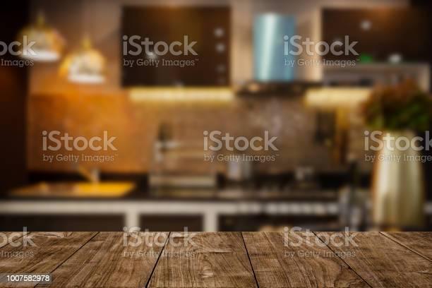 Modern luxury kitchen black golden tone with wooden tabletop space picture id1007582978?b=1&k=6&m=1007582978&s=612x612&h=xwcx2nhdjq73cvawalwwq7on5akqgr3sxrzym4nyvgq=