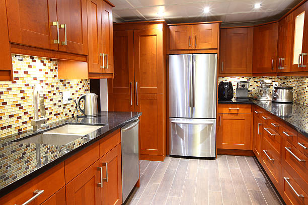 modern luxury kitchen with stainless steel appliances - küche neu gestalten ideen stock-fotos und bilder
