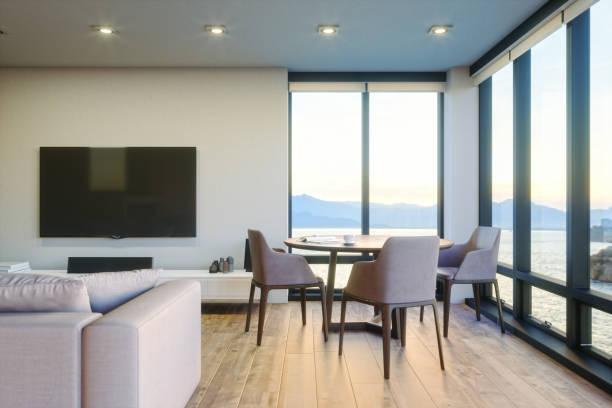 Modernes Luxus-Wohnzimmer mit Ocean View bei Sonnenuntergang – Foto