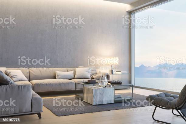 Modern luxury living room with ocean view at sunset picture id859167776?b=1&k=6&m=859167776&s=612x612&h=04sr7trkmkupt sgeslwu00rtpn2yvy7msgafsn01u8=