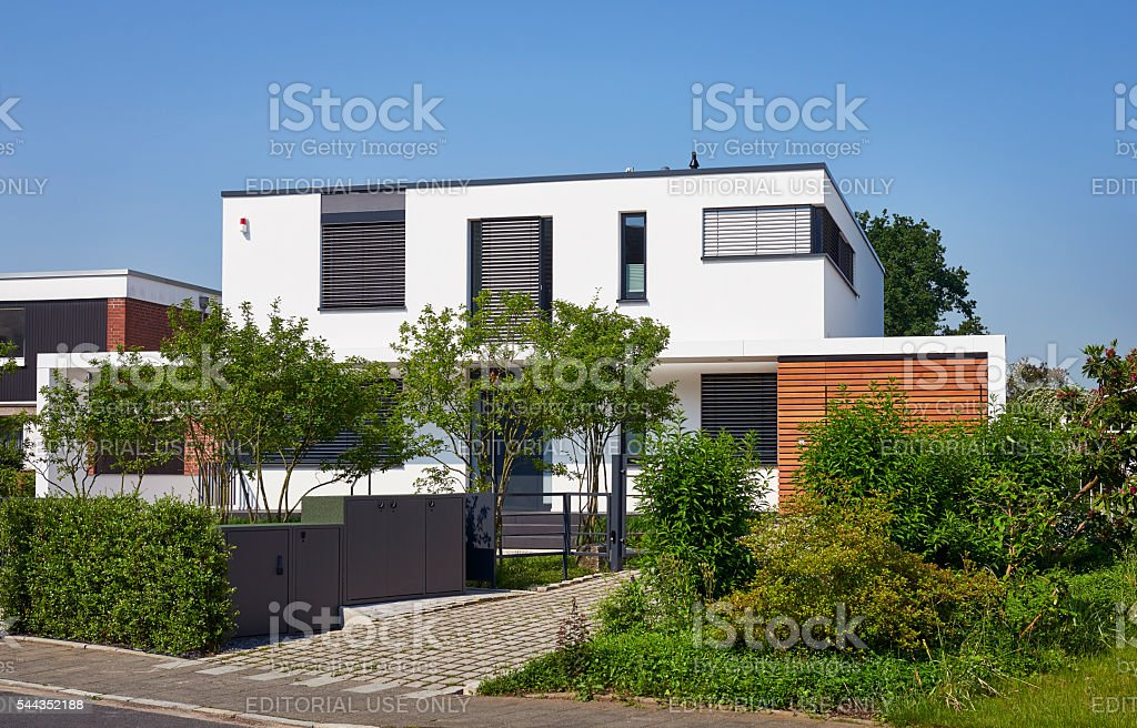 Modern luxury white house with front garden stock photo