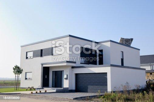 istock Modern luxury white house with garage 184859699