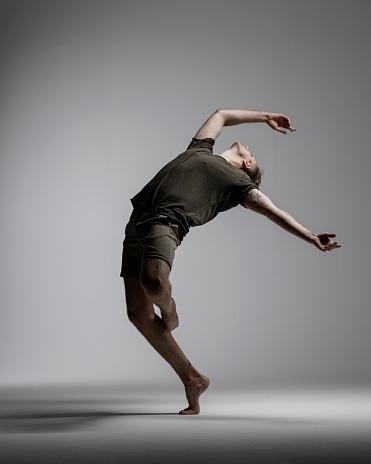 Modern Male Dancer on gray background