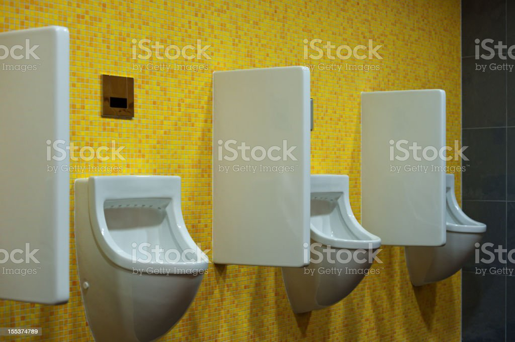 Modern Male Toilet Urinal With Yellow Mosaic In Hotel Restaurant Stock Photo Download Image Now Istock