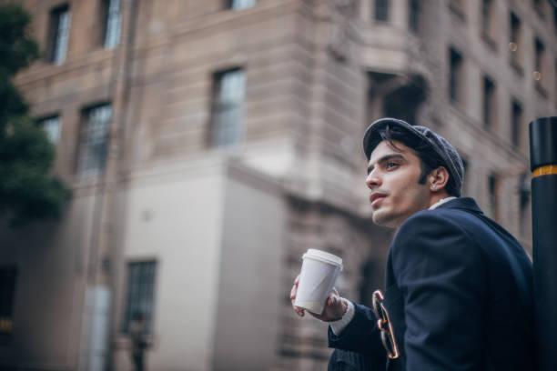 Modern man drinking coffee stock photo