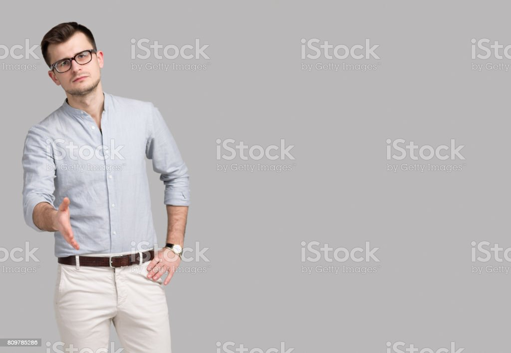 A Modern Man Holds Out His Hand for Greetings stock photo