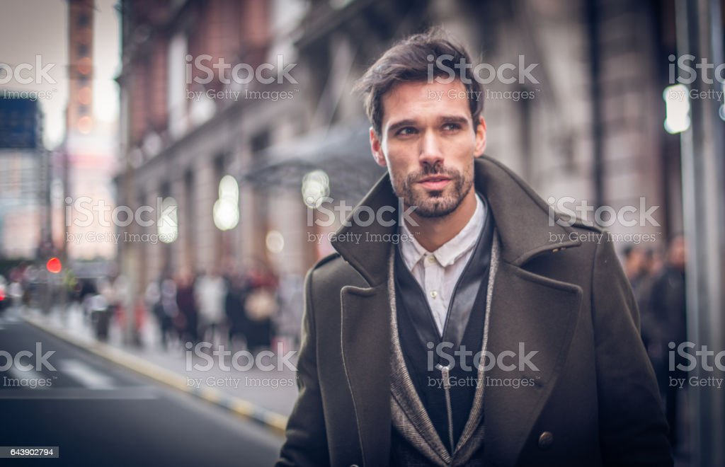 Modern man in winter coat stock photo