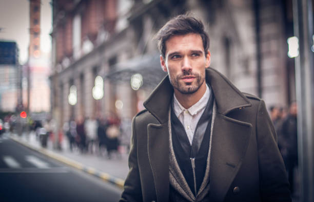 modern man in winter coat - handsome people stock photos and pictures