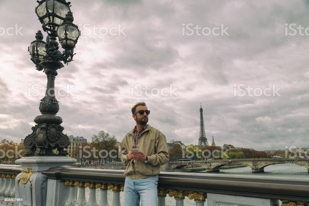 Modern man using smart phone in the European city. stock photo