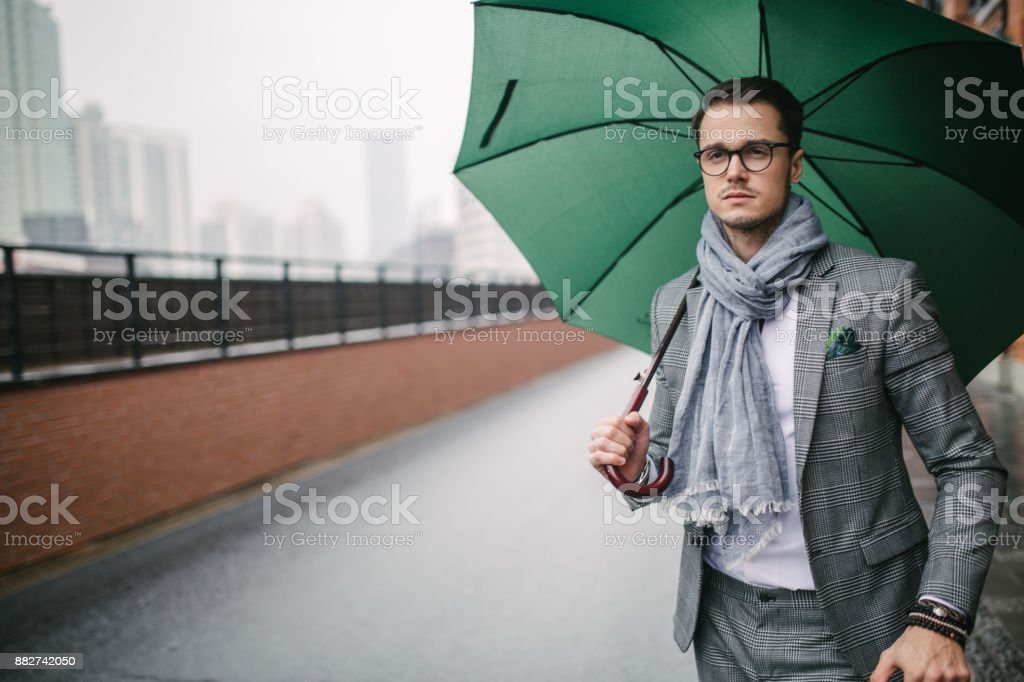 Modern man with umbrella stock photo