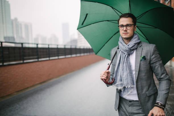 Modern man with umbrella stock photo