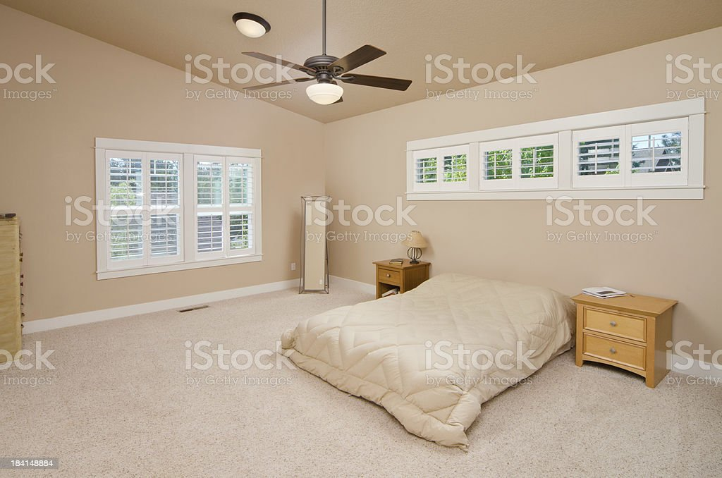 Modern master bedroom with furniture royalty-free stock photo
