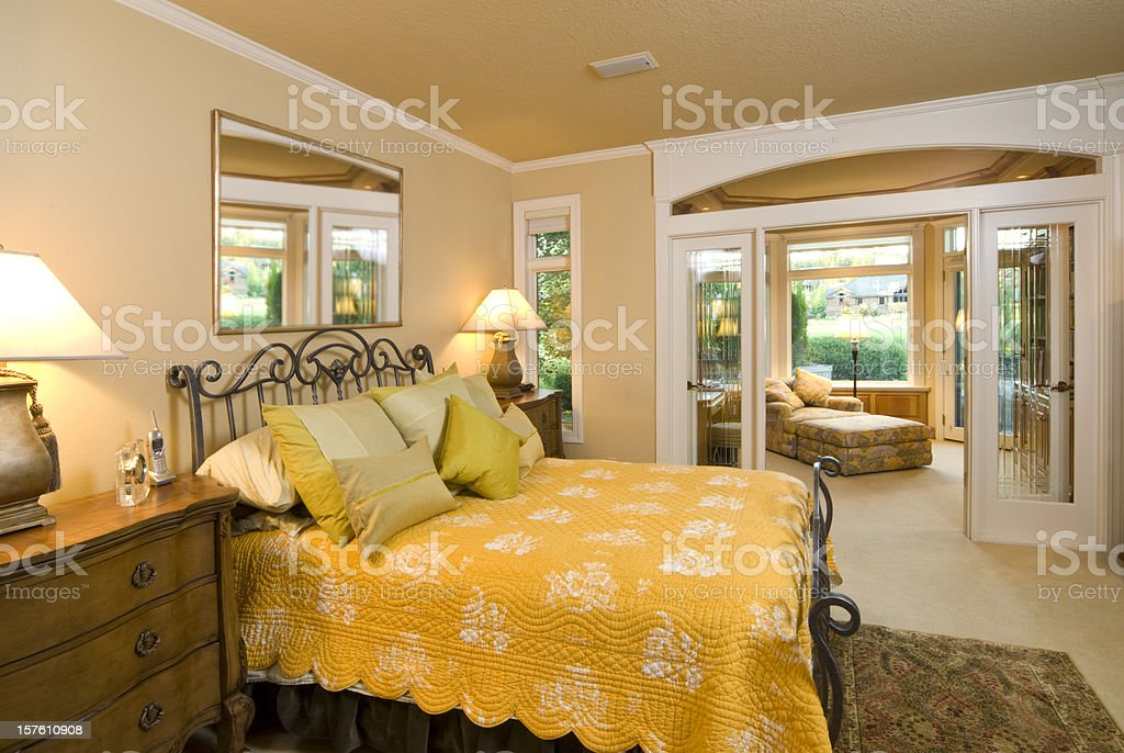 Modern master bedroom with separate sitting area stock photo