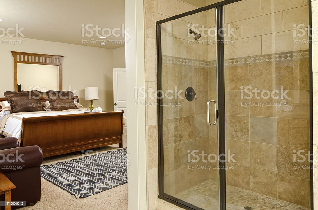 Modern master bedroom with shower royalty-free stock photo