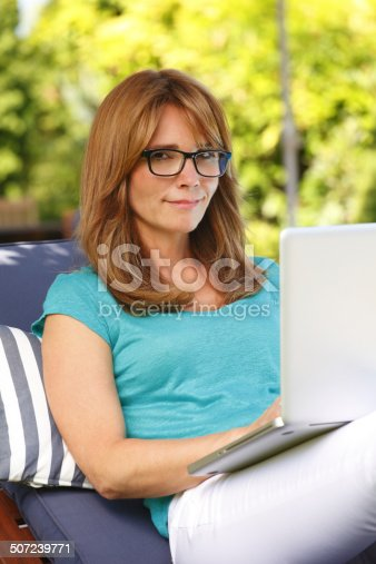 919520858 istock photo Modern mature woman portrait with laptop 507239771
