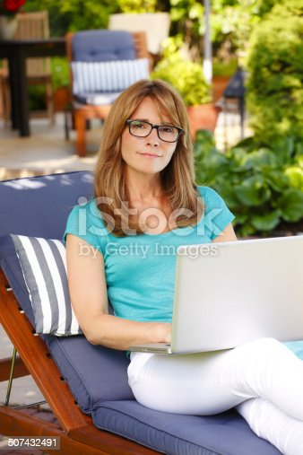 919520858 istock photo Modern mature woman portrait with laptop 507432491