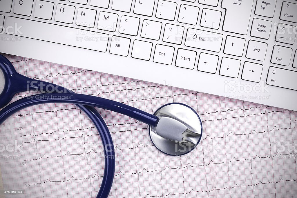 Modern medicine:Stethoscope and keyboard on electrocardiogram royalty-free stock photo