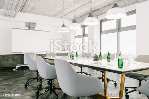 Interior of a modern luxury board room with technology equipments.