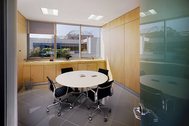 Modern meeting room with round table and four chairs stock photo