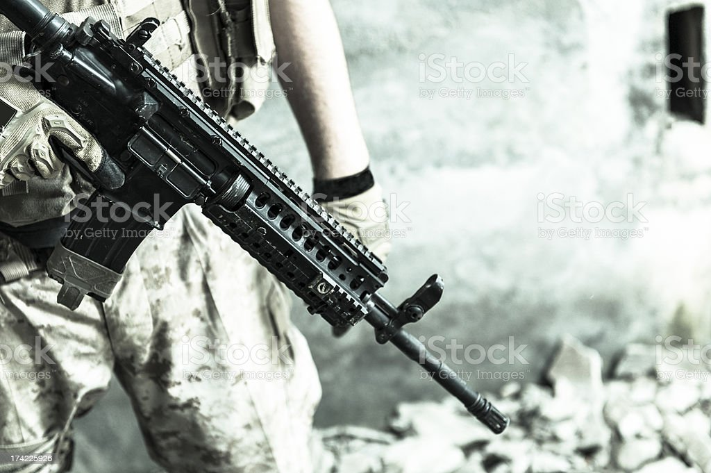 Modern Mercenary Soldier Carrying Automatic Assault Rifle stock photo