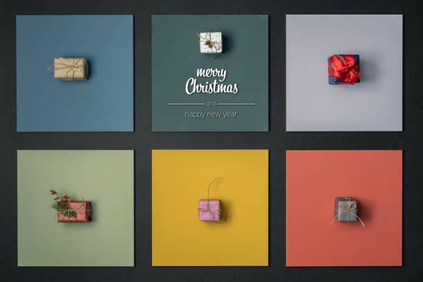 モダンなクリスマスと垂直方向上の幸せな新年のご挨拶ギフト プレゼント ボックス デザインでカラフルなフレームを表示します。クリスマス冬のホリデー シーズンのソーシャル メディア � - アイコン プレゼント ストックフォトと画像
