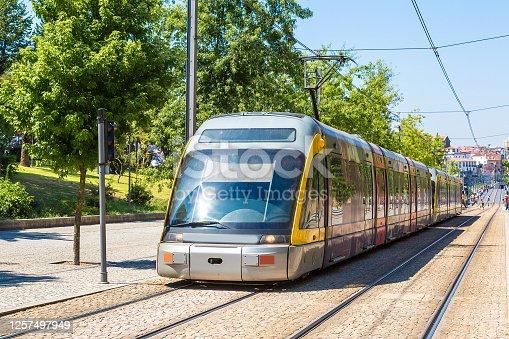 Modern metro train on the bridge in Porto in a beautiful summer day, Portugal