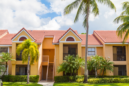 Modern middle-class colorful painted building details at Hammocks Doral neighborhood in Miami, Florida, United States of America, USA, sunlight illuminating at midday with a blue deep sunny summer sky.