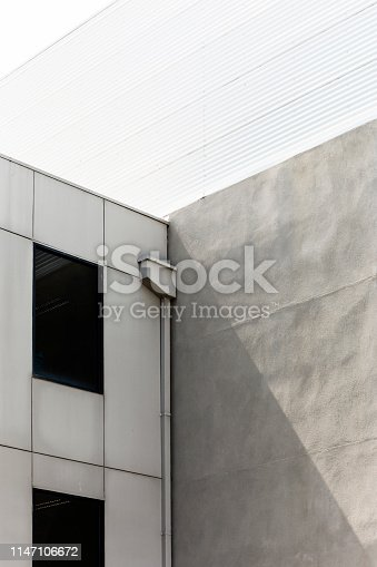 istock Modern Minimal Concrete Corner On Summers Day 1147106672