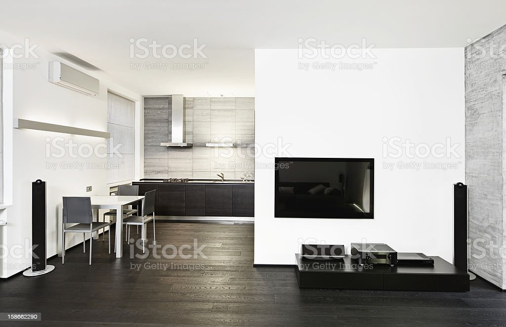Modern minimalism style kitchen and drawing room interior in monochrome royalty-free stock photo