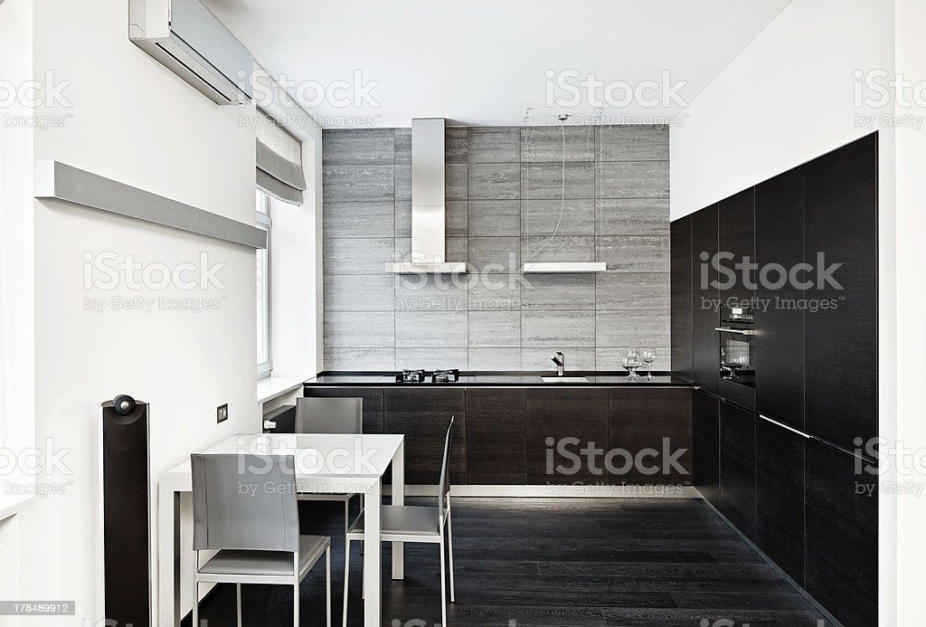 Modern minimalism style kitchen interior in monochrome tones royalty-free stock photo