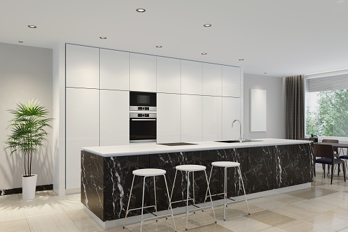Luxury interior apartment with minimalist modern kitchen and dining room.